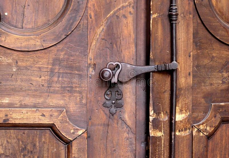 Brass door knob on wooden door stock images