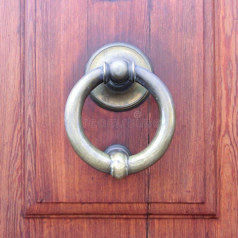 Brass Door Knocker. On a wood door royalty free stock photography