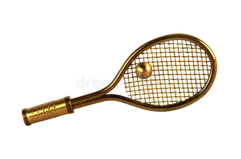 Brass tennis racket and ball. Brass figurine or miniature of tennis racket and ball isolated on white background stock images