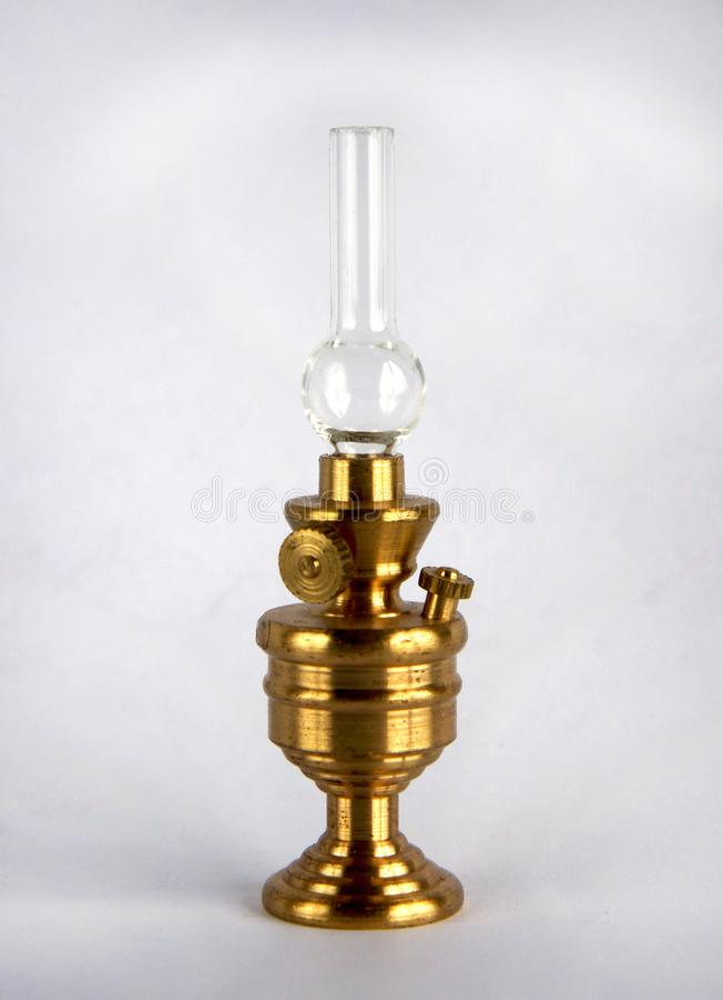 Vintage kerosene lamp. Brass figurine or miniature of vintage kerosene lamp on white stock photos