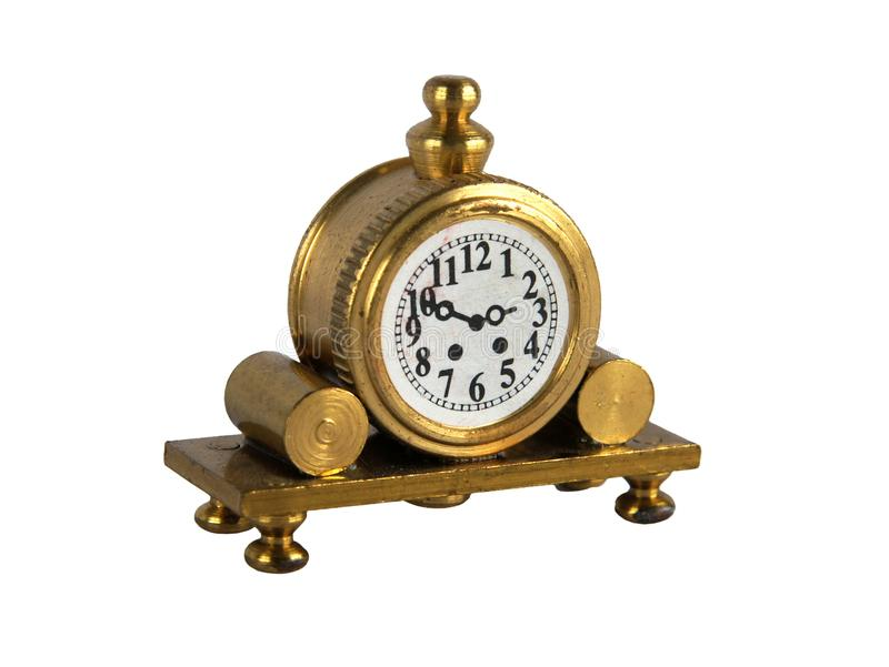 Vintage mantel clock. Brass figurine or miniature of vintage mantel clock isolated on white background royalty free stock photos