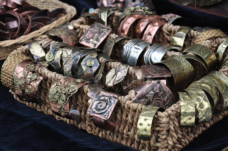 Brass jewelry. At handicraft market royalty free stock photo