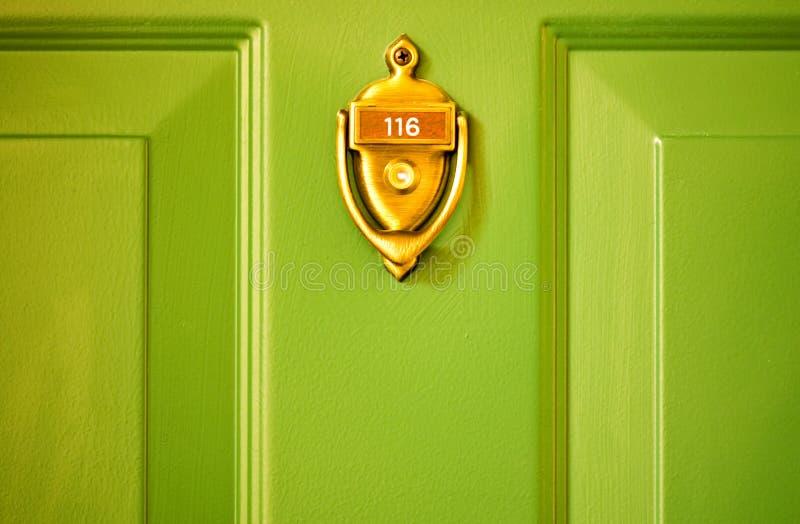 Brass Knocker Green Door