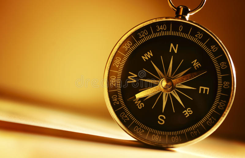 Brass magnetic compass royalty free stock photography