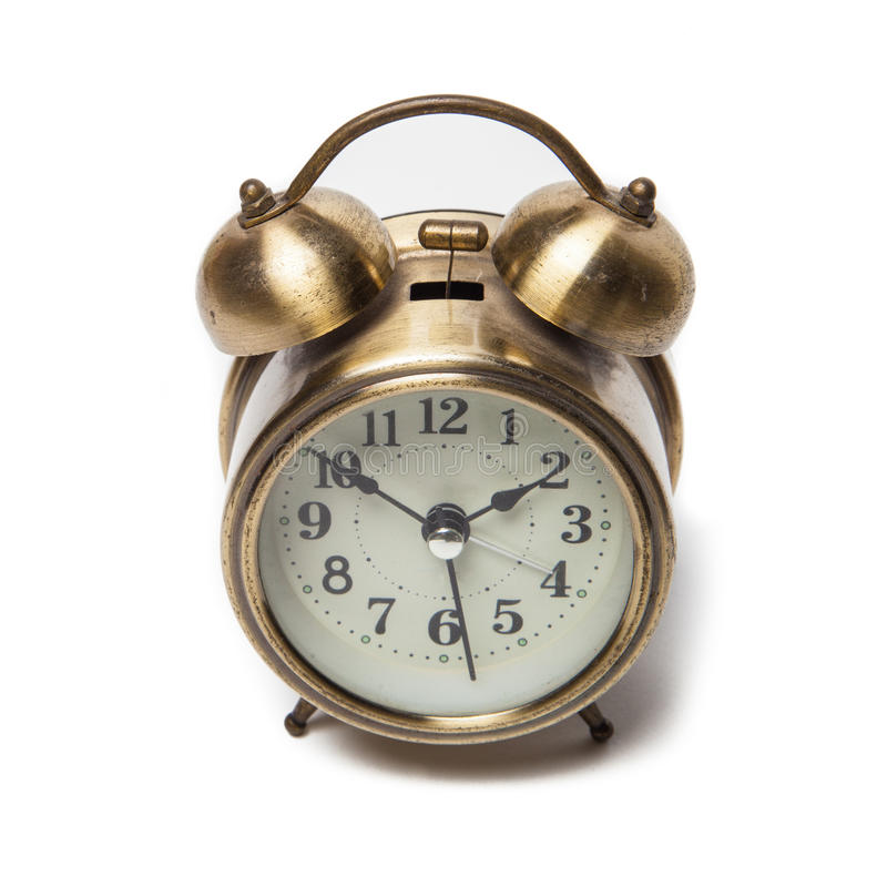 Brass metal alarm clock retro style. A Brass metal alarm clock retro style stock photo