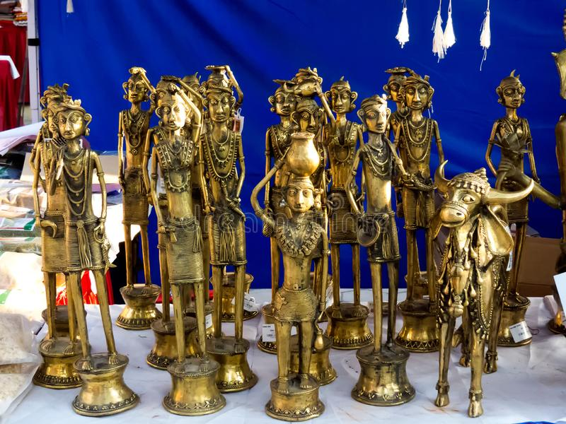 Brass metal artifacts of tribal life India. Group of brass sculptures, idols demonstrating tribal, rural life of India. There are men, women, children, animals royalty free stock image
