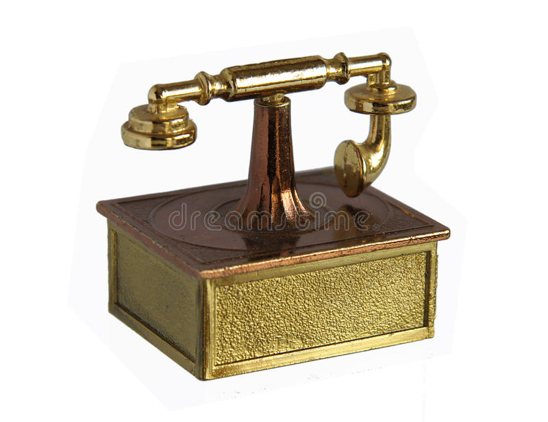 Brass miniature of vintage Telephone stock photos