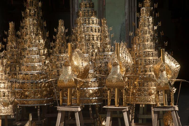 Brass Myanmar art for worship. MANDALAY,MYANMAR -JULY 2 : Art handmade brass Burmese craftsmen To decorate the temple pagoda in Myanmar. Sold on the roadside stock photo