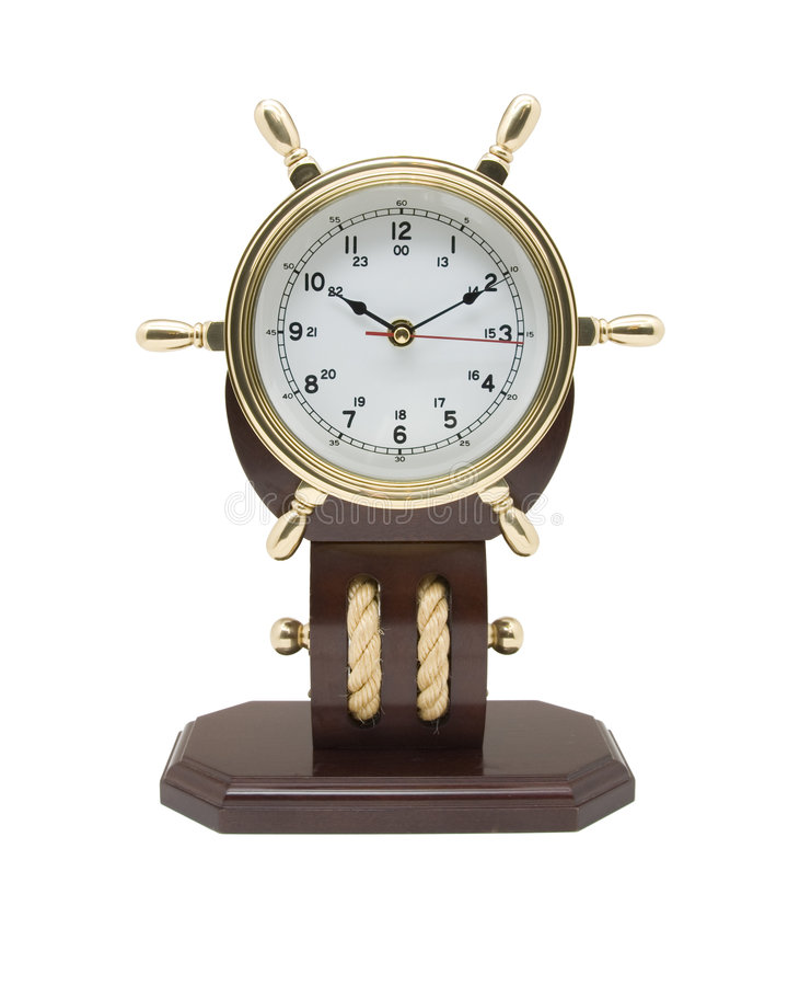 Brass Nautical Clock. Brass Clock with a nautical theme isolated on a white background royalty free stock photography