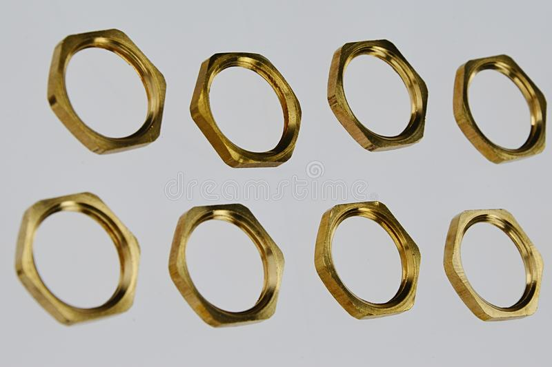 Brass nuts used on electric grounding terminals royalty free stock image