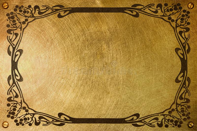 Nameplate with liberty style frame. A brass plate with an etched liberty style frame for a nameplate stock photography
