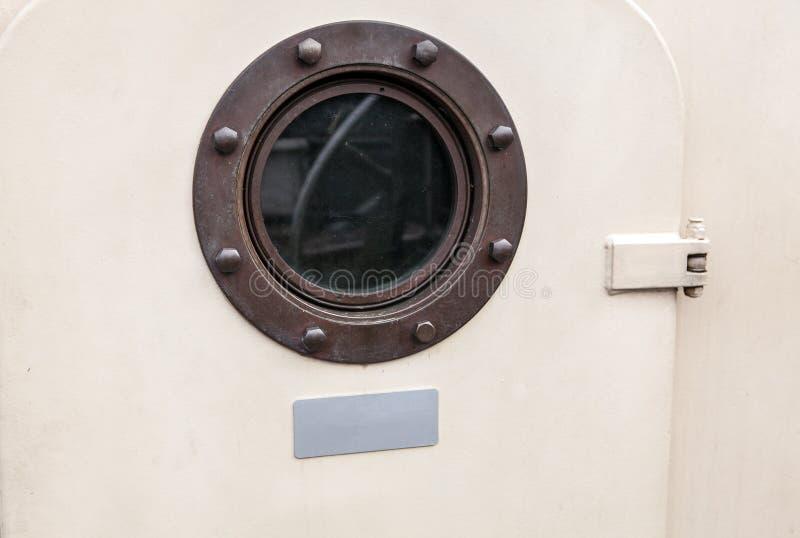 Brass porthole - ferry window frame.  stock photos