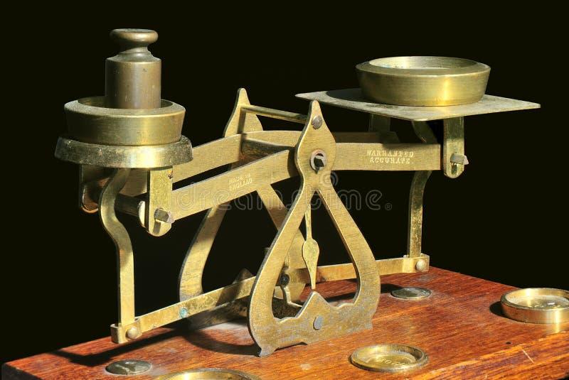 Brass Scales, Balance Type. Old brass balance scales. Studio shot, black background stock photo