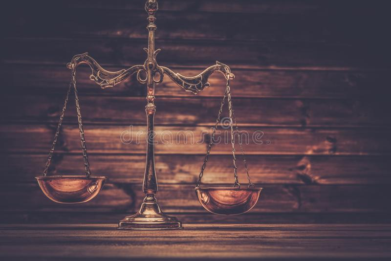 Brass scales. Over wooden background royalty free stock photo
