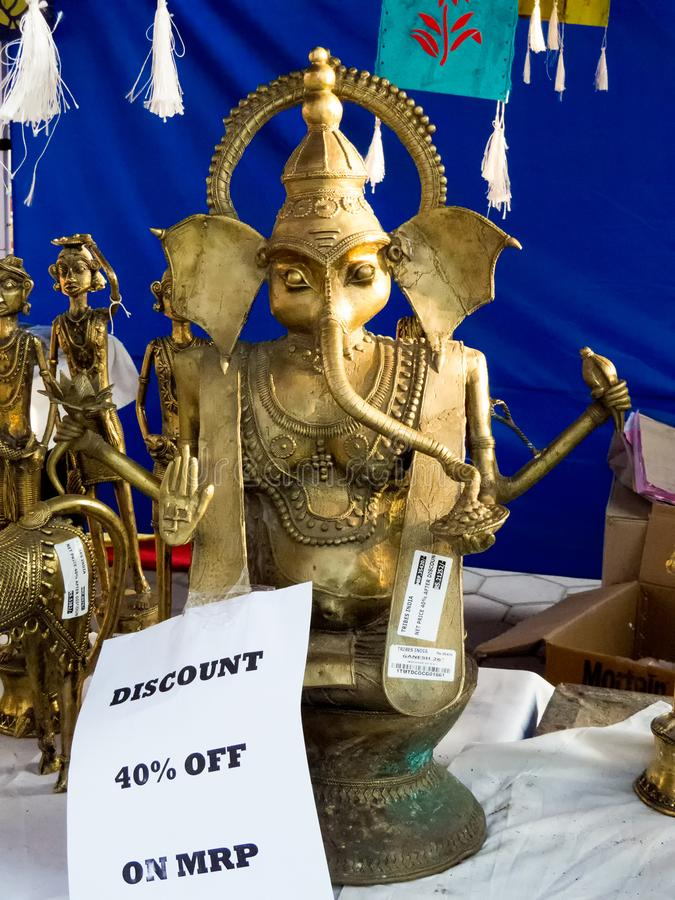 Brass Statue of Ganesha -India. Brass Statue of Ganesha for sale in a tribal art and handicraft fair held in Indore city, India stock image
