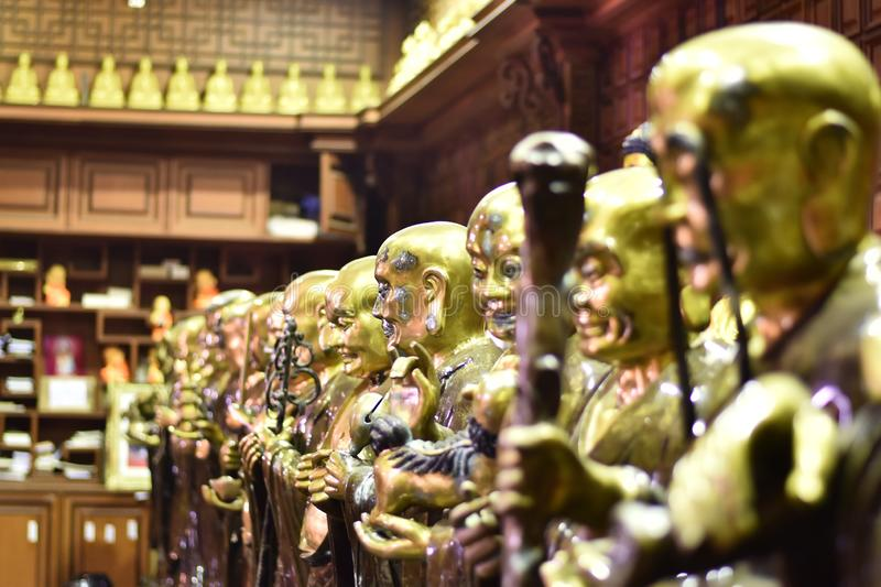 Brass statues of Chinese gods standing stock images