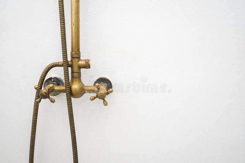 Brass water tap vintage design in shower box stock images