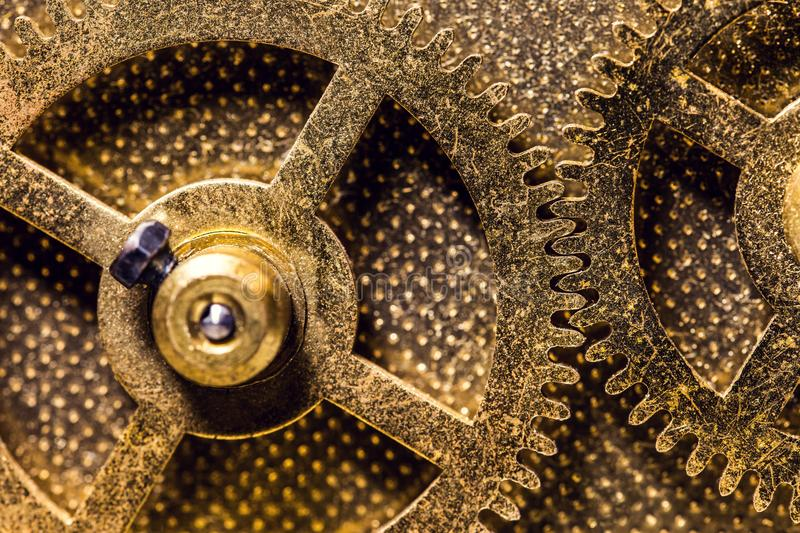 Brassy Cogwheels or Gearwheels, concept movement and mechanical royalty free stock photo