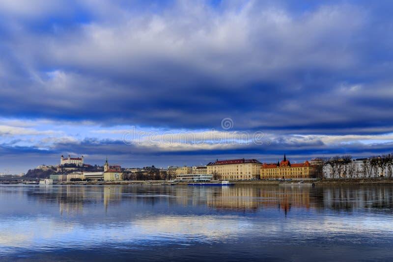 Bratislava castle, st. Martins church and Danube river, blue win royalty free stock photos