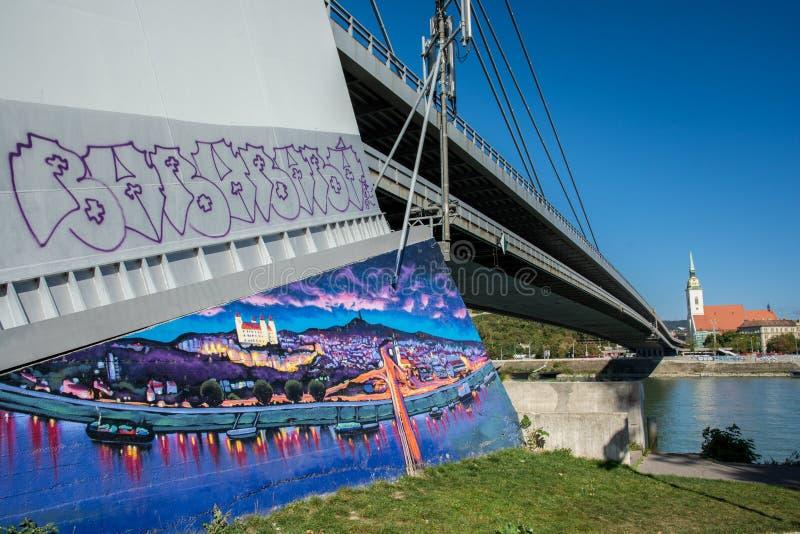 Bratislava cityscape med målning av staden på den nya bron royaltyfria foton