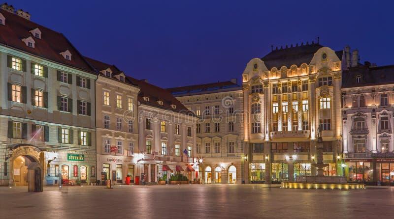 Bratislava - Main square in evening dusk with more architectonic styles. BRATISLAVA, SLOVAKIA - JANUARY 23, 2014: Main square in evening dusk with more royalty free stock photo