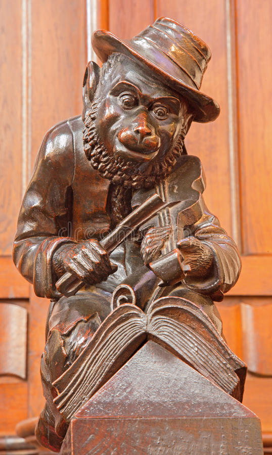 Free Bratislava - Monkey With The Violin Sculpture From Bench In Presbytery In St. Matins Cathedral Stock Photography - 50102552