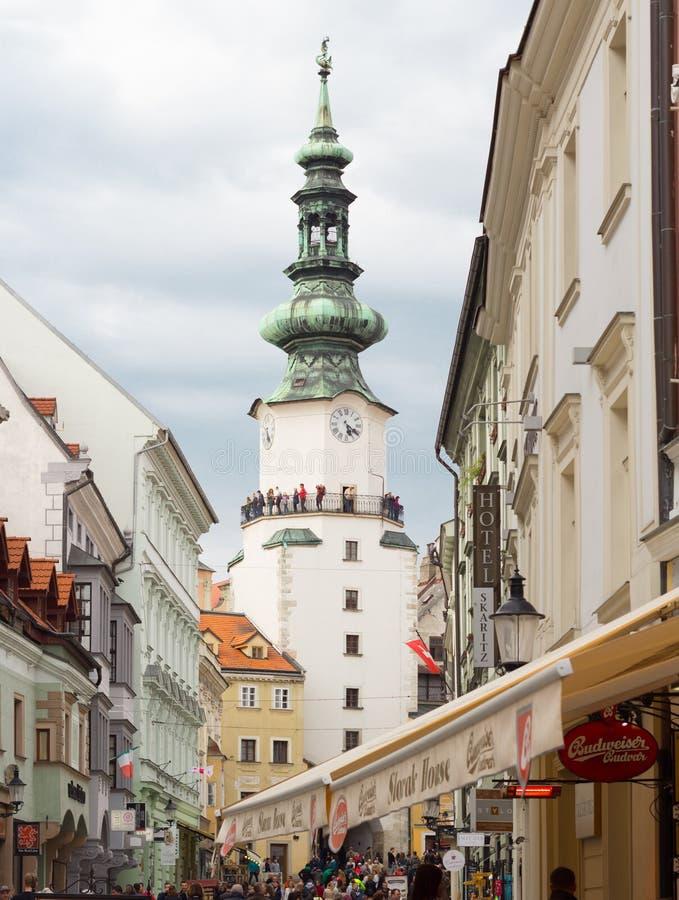 BRATISLAVA, SLOVAKIA - APRIL 2016 - tourists sightseeing on Michalska street in Bratislava`s old town. Tourists sightseeing on Michalska street in Bratislava`s stock photo