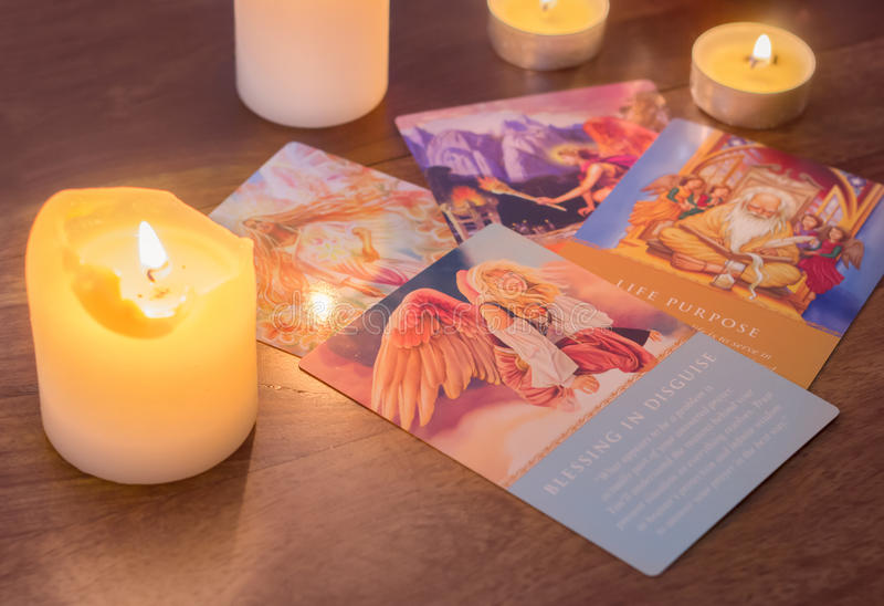 Bratislava, Slovakia, February 2, 2017: illustrative and editorial tarot cards and burning candle on wooden table royalty free stock photo