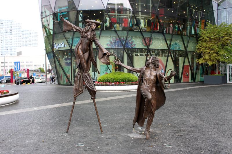 Colin Spofforth sculptures in Eurovea. BRATISLAVA, SLOVAKIA -  JULY 12, 2019: Olga and Pat, sculptures by english artist Colin Spofforth in front of the Eurovea stock photos