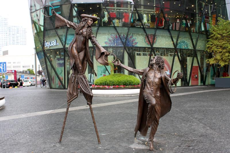 Colin Spofforth sculptures in Eurovea. BRATISLAVA, SLOVAKIA -  JULY 12, 2019: Olga and Pat, sculptures by english artist Colin Spofforth in front of the Eurovea stock image