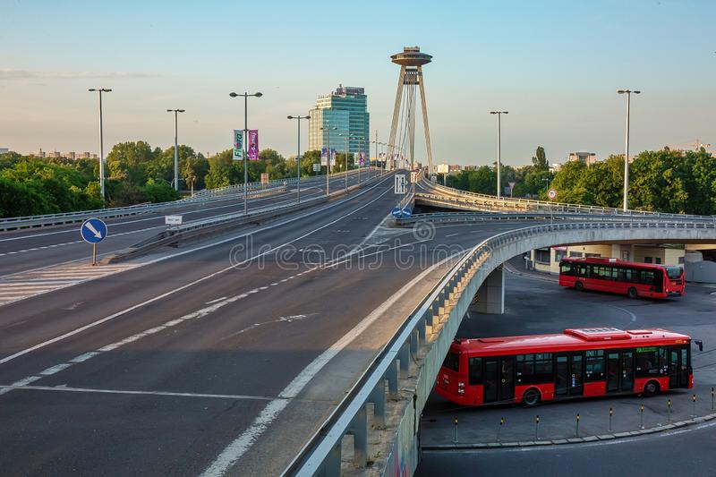 BRATISLAVA, SLOVAKIA - May 6th, 2018: Early morning in Bratislava, empty road and buses starting on daily routes. BRATISLAVA, SLOVAKIA - May 6th, 2018: Early stock image