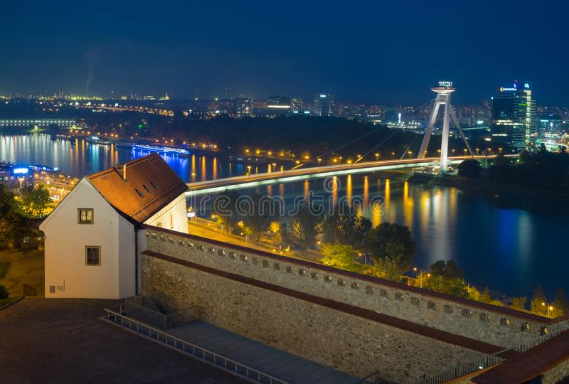 Night view from the Bratislava Castle on the Danube River and futuristic bridge SNP stock images