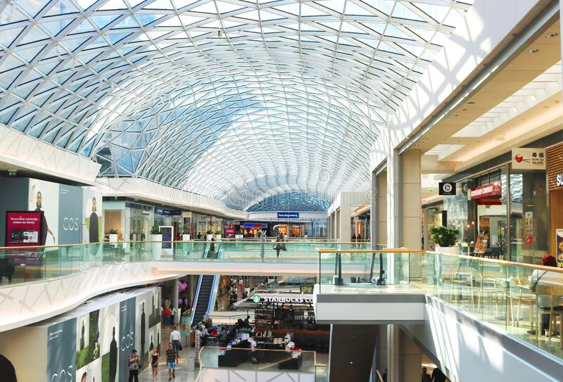Unidentified people in retail, business and residential complex Eurovea in Bratislava, Slovakia. Glass ceiling stock photos