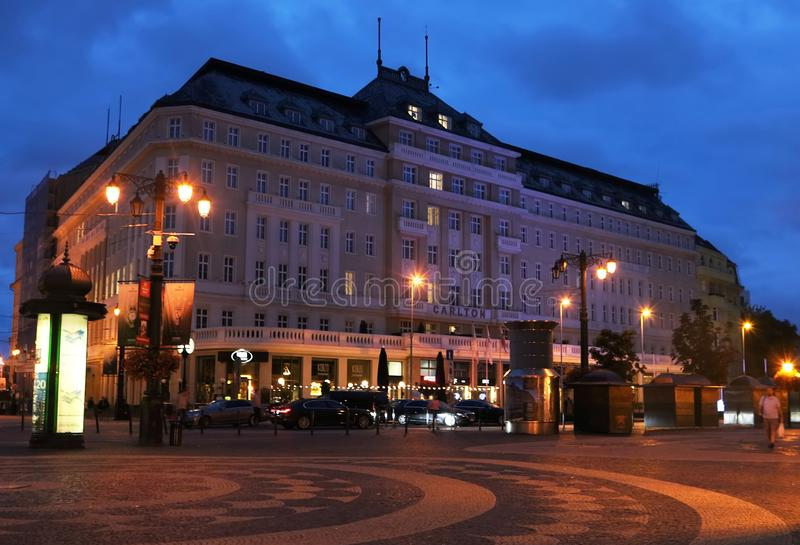 View of Carlton hotel at Hviezdoslavovo namestie in the Old Town near Slovak National Theatre in the evening, Bratislava, Slovakia stock photography