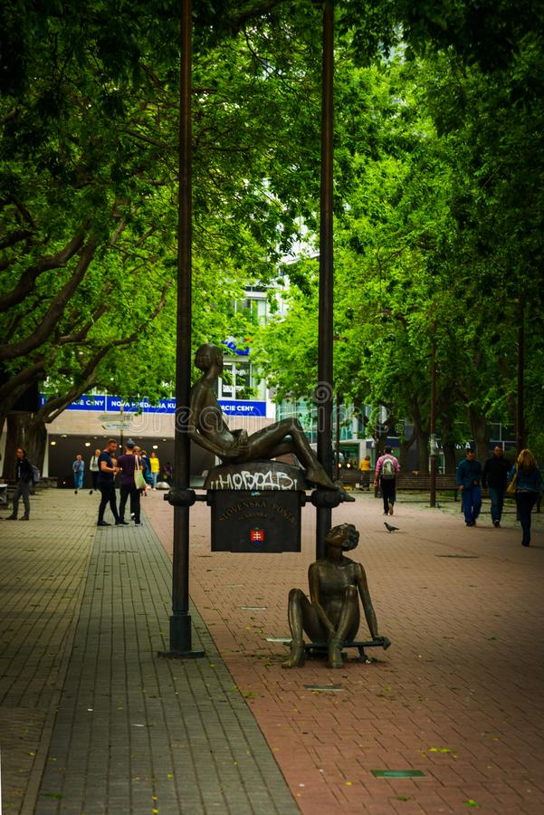 Bratislava, Slovakia: statue that marks the first Slovak mailbox. Sculpture of two girls - postmen who work at the post office. Bratislava, Slovakia: Beautiful royalty free stock photos