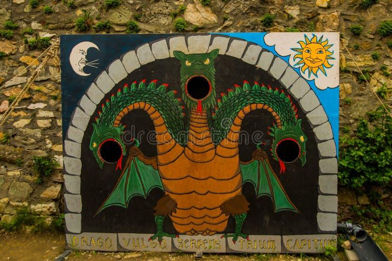 Bratislava,Slovakia: Tantamareski depicting the three-headed fairy dragon, a photo stand for a photo shoot tourists. Devin Castle royalty free stock photo