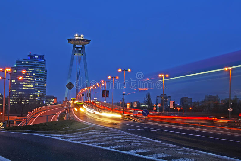 Bratislava traffic at dusk. Bratislava traffic via the New Bridge over the River Danube at dusk stock photos