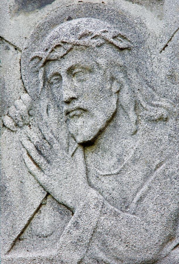 Bratislava - ulga jezus chrystus z krzyżem od 19. centu. na grobowu w cmentarza Na Kozej brane zdjęcie stock