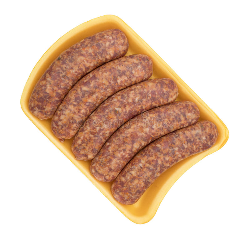 Bratwurst links on a yellow foam tray. Top view of spicy bratwurst links on a yellow foam butcher tray atop a white background stock images