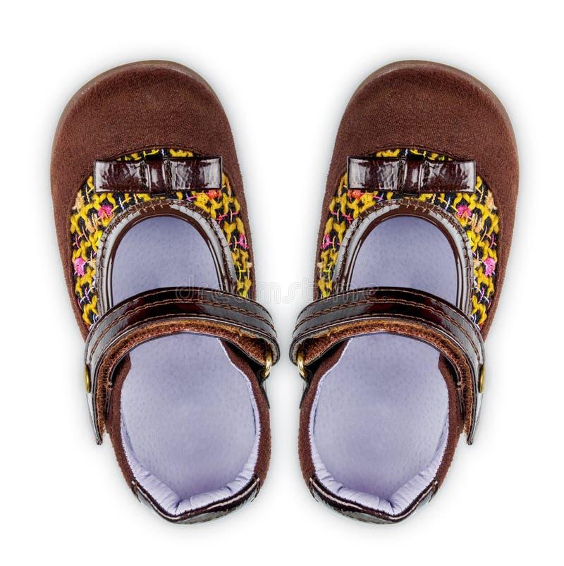 Braune Schuhe des Mädchens lizenzfreie stockbilder