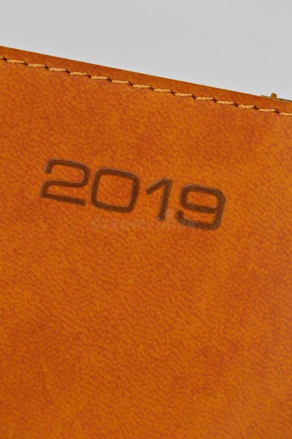 braunes Leder 2019 mit genähter Tagesordnung stockbilder