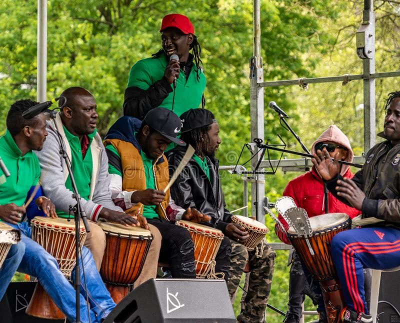 Group of black musicians at a concert with drums at a festival for the first of May, Labour Day stock images
