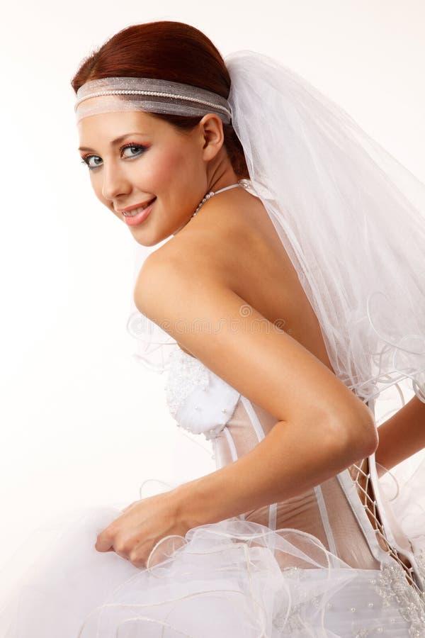 Braut blickt über ihrer Schulter flüchtig lizenzfreie stockfotos