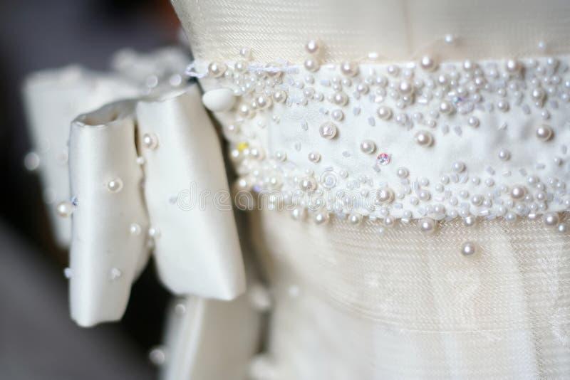 Brauthochzeits-Kleid stockbild