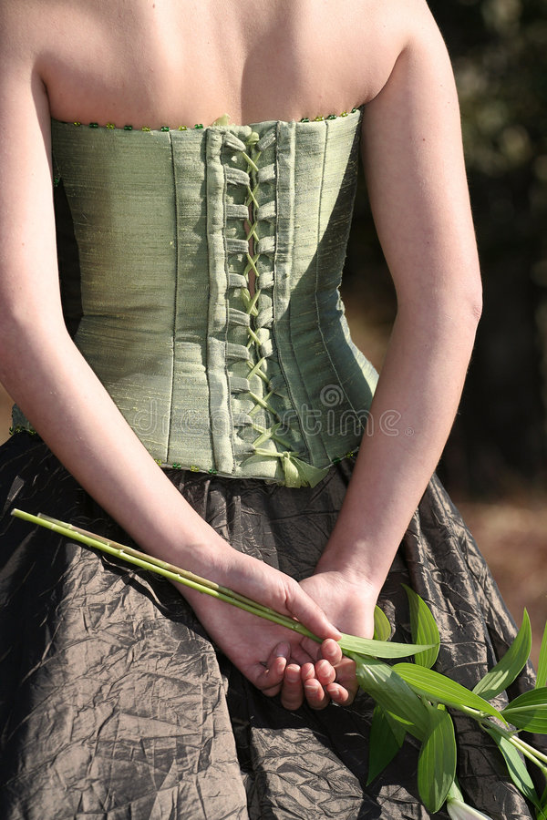 Brautrückseite, mit Blume lizenzfreie stockfotografie