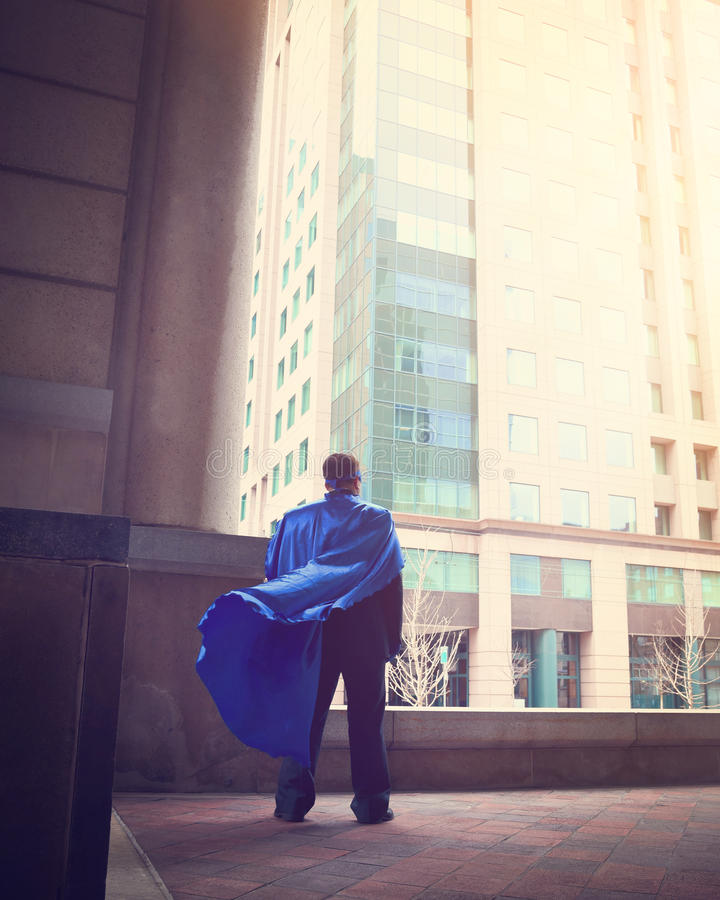 Brave Super Business Man Standing in City stock image