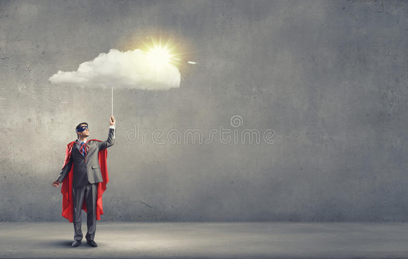 Brave super hero. Young confident super guy in mask and cape royalty free stock image