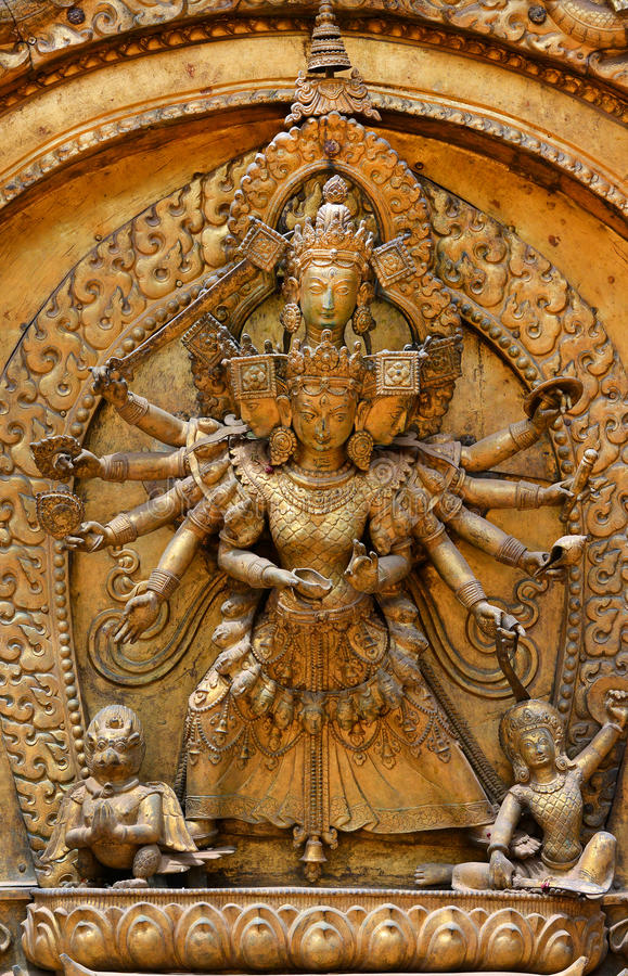 Brazen relief, sculpture of Shiva. The destroyer on the entrance of Bhaktapur Royal Palace. Durbar square. Kathmandu, Nepal stock photography