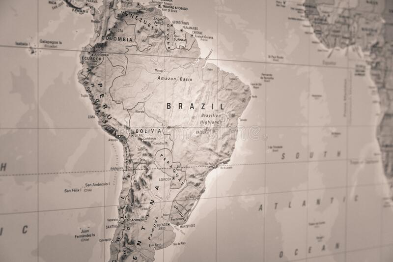 Brazil on a world map. Brazil standing out on a world map in black and white stock photo