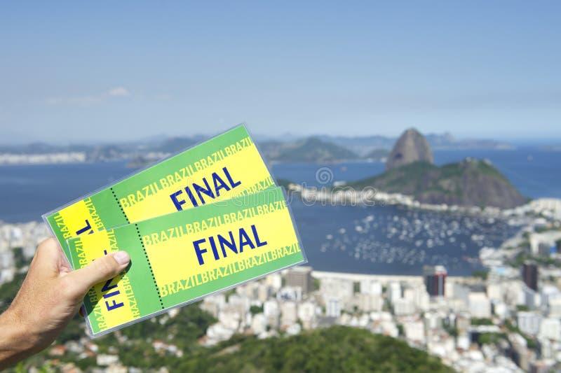 Brazil Final Tickets Rio de Janeiro Skyline. Hand holding pair of final tickets up at city skyline overlook Rio de Janeiro Brazil stock images